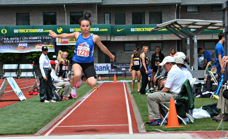 SUBMITTED PHOTO - Olivia Symons places eight in the long jump at state.