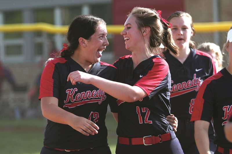 PHIL HAWKINS - Kennedy seniors Abby Frey (left) and Tressa Riedman celebrate following the conclusion of the Trojans' 7-1 win over Central Linn on May 15, giving the Trojans their third straight league title.