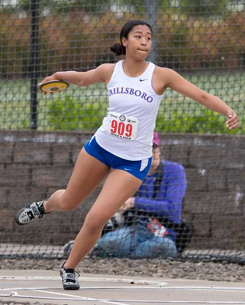 STAFF PHOTO: CHRISTOPHER OERTELL - Hillsboro's Naomi Johnson throws the discus during the OSAA 5A State Track and Field Championships May 18-19, at Hayward Field in Eugene.