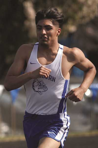 PHIL HAWKINS - Woodburn junior Giovanni Bravo dropped his time to 4:00.55 in the 1500-meter race to place sixth at the 5A State Championships on Saturday.