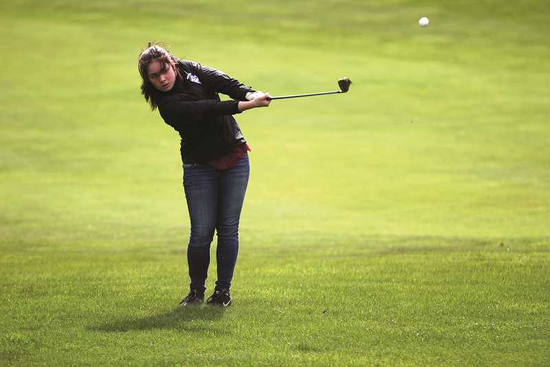 PHIL HAWKINS - Woodburn sophomore Haley Elsasser set a new personal-best score of 88 and tied with teammate Bailey Woolley for a team-best 15th-place finish at the 2018 5A Girls Golf State Championships.