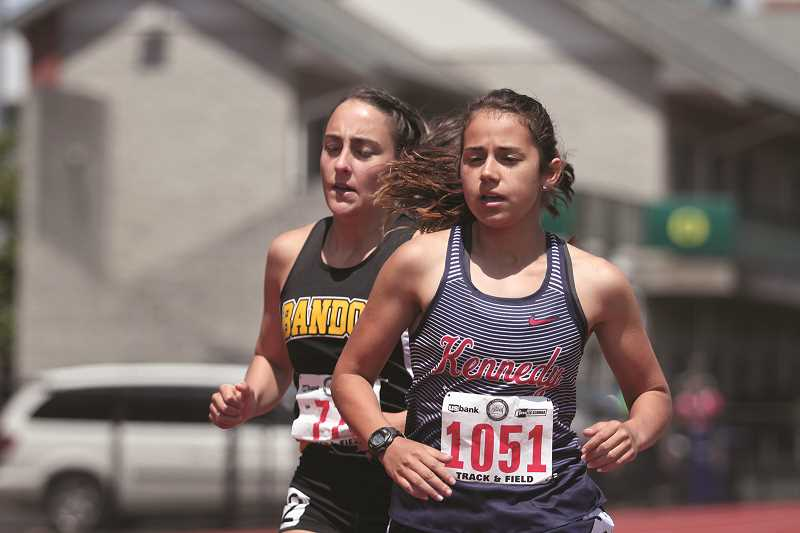 PHIL HAWKINS - Kennedy juniors Alejandra Lopez (at top) and Hallie Sprauer paced the Trojans at the 2018 2A State Track and Field Championships on Thursday and Friday. Lopez led the team with a pair of runner-up finishes in the 1,500- and 3,000-meter runs, while Sprauer placed in the high jump, triple jump, long jump and as a member of the school's 4x100 relay team. The pair accounted for more than half of the Trojans' 49 points, giving Kennedy a fourth-place finish in the team standings.