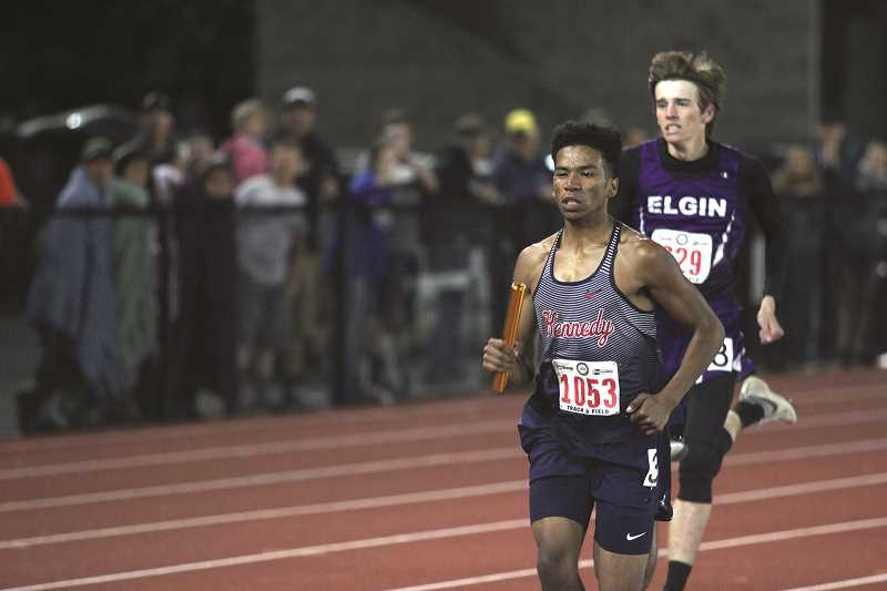 PHIL HAWKINS - Kennedy junior Micah Parker brought the Trojans from seventh to fourth, running the final leg of the 4x400 relay race on Friday.