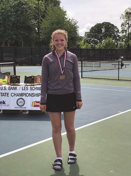 SUBMITTED PHOTO: MIKE CLARKE - Mollie Lewandowski poses with her third place medal in Corvallis.