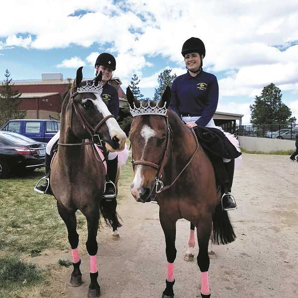 One of Canby High's working pairs teams, Megan Schweitzer and Lauren Augustus, get ready for their competition at the recent state equestrian championships in Redmond.