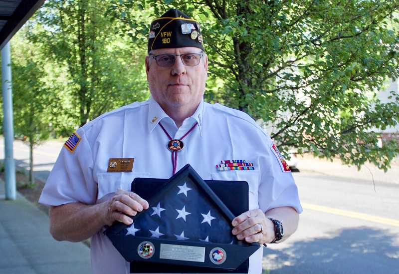 OUTLOOK PHOTO: CHRISTOPHER KEIZUR - Gresham United VFW Post 180 Commander-elect David Lowe believes in the importance of the American flag as a symbol for those who served.