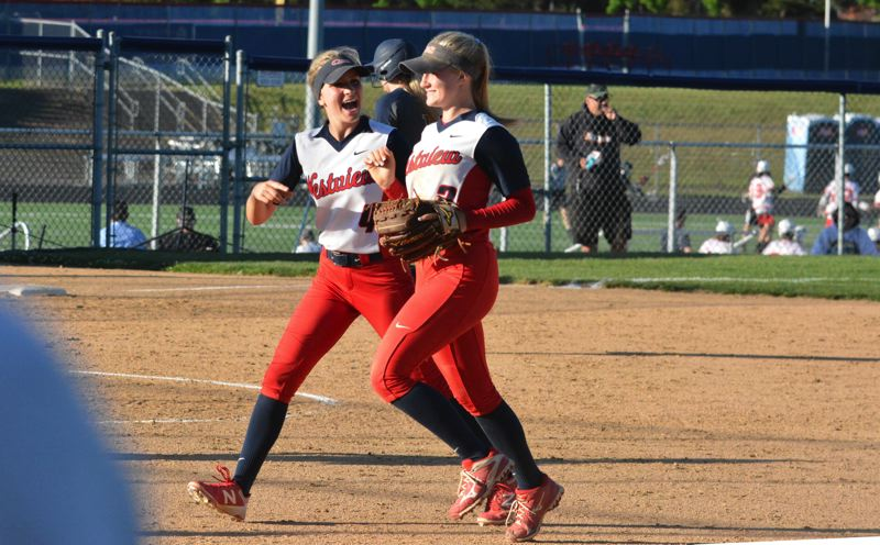 TIMES PHOTO: MATT SINGLEDECKER - Westview middle infielders Emma Antich and Taylor Alto celebrate a huge double play against Lake Oswego in the first round of the Class 6A playoffs.