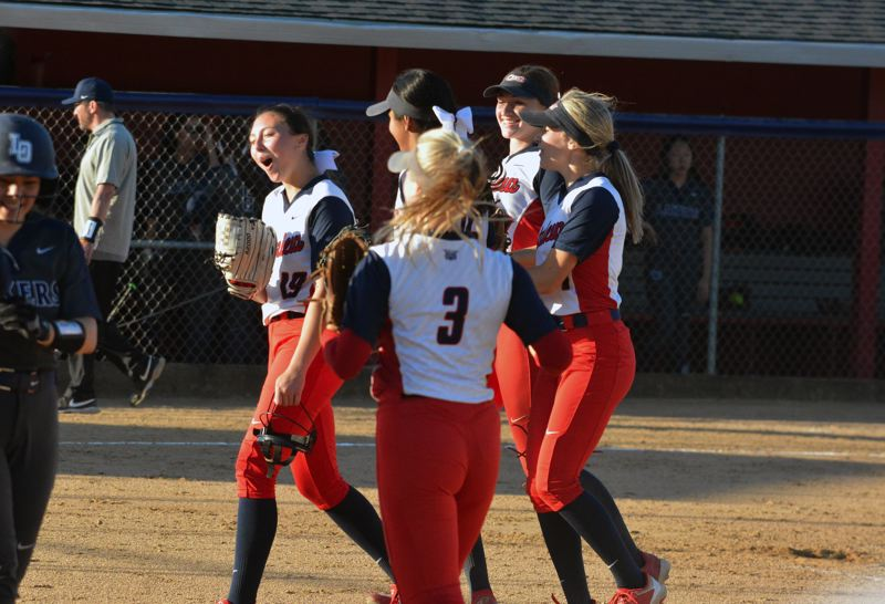 TIMES PHOTO: MATT SINGLEDECKER - Westview freshman Julia Jordan and the Westview softball celebrate their first round win over Lake Oswego.