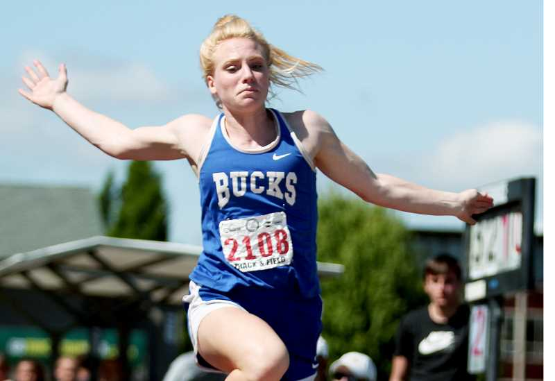 SETH GORDON - St. Paul's Isabelle Wyss earned a state title in the triple jump Saturday at the Class 2A track and field championships at historic Hayward Field in Eugene.
