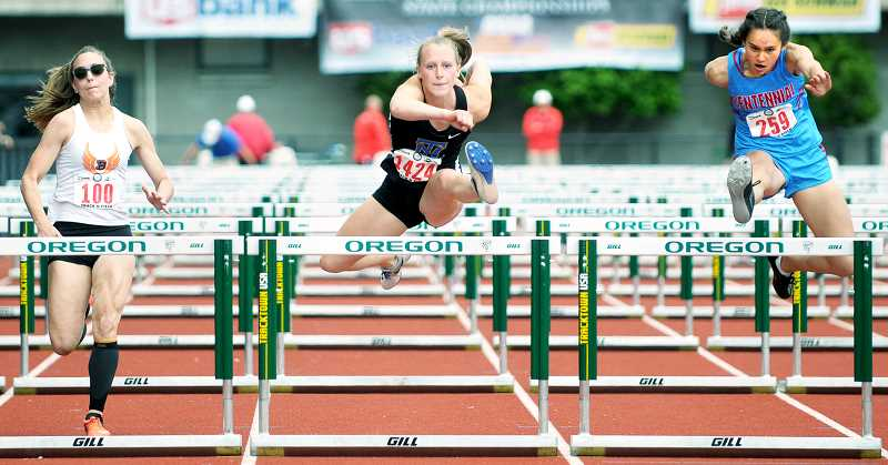 SETH GORDON - Newberg senior Ashley Korb-Doty qualifies third during the prelims of the 100 hurdles Friday at the OSAA Class 6A state track and field meet in Eugene. Korb-Doty placed fourth in the finals in 15.06. The Tiger girls were 21st as a team with 12 points.