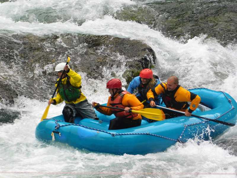 ESTACADA NEWS PHOTO: EMILY LINDSTRAND - Upper Clackamas Whitewater Festival Attendees put their skills to the test on the Clackamas River.