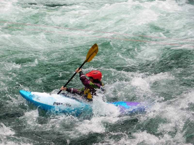 ESTACADA NEWS PHOTO: EMILY LINDSTRAND - A kayaker participates in a race during the Upper Clackamas Whitewater Festival, which took place last weekend near Carter Bridge in the Mt. Hood National Forest.