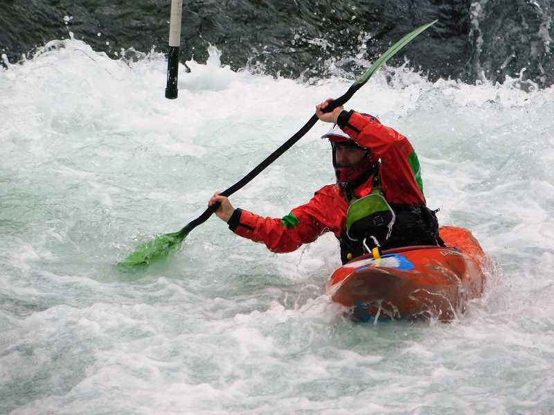ESTACADA NEWS PHOTO: EMILY LINDSTRAND - A kayaker races along the Clackamas River during the Upper Clackamas Whitewater Festival last weekend.