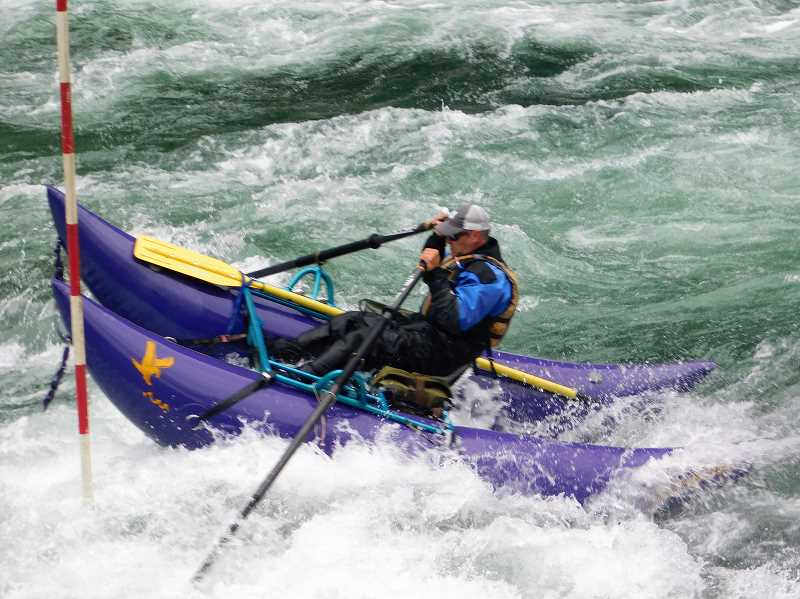 ESTACADA NEWS PHOTO: EMILY LINDSTRAND -  A boater rides a rapid during one of the Upper Clackamas Whitewater Festivals competitive events last weekend.