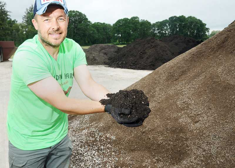 GARY ALLEN - Worm Farm Portland owner Igor Lochert shows off one of the rich soils the Highway 240 business has for sale.