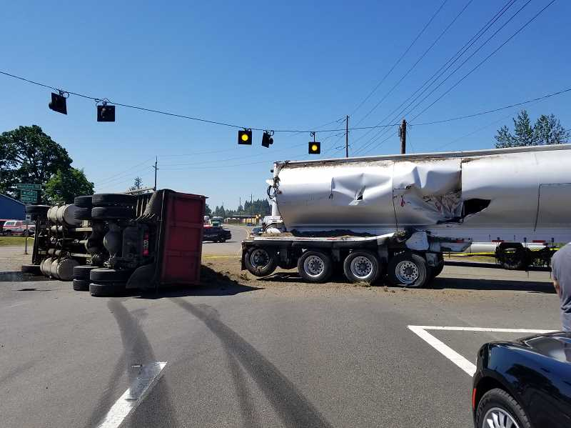 COURTESY PHOTO: MOLALLA FIRE DISTRICT - On Tuesday, May 22 at approximately 11 a.m. a dump truck and a semi-truck crashed on Highway 213 at Macksburg Road.