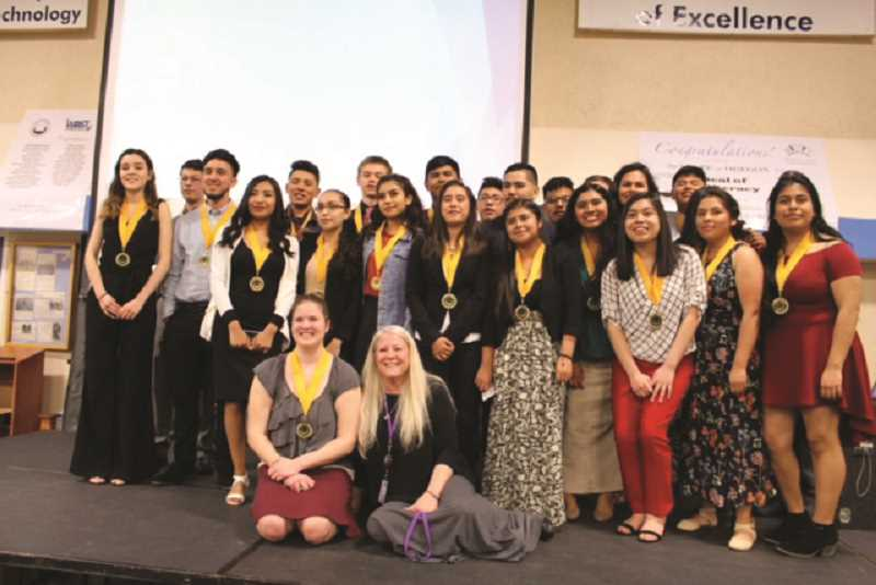 COURTESY PHOTO: LYNNE KOENIG - Seal of Biliteracy recipients from Woodburn Academy of Art, Science and Technology pose for a photo with Principal Geri Federico.