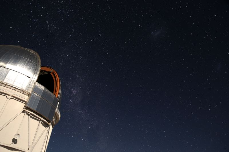 PHOTO COURTESY OF PAT HANRAHAN - Hanrahan's image of the Southern Sky above the Blanco telescope on Cerro Tololo in northern Chile. Prominent features of the sky include the Milky Way and the Large Magellanic Cloud.
