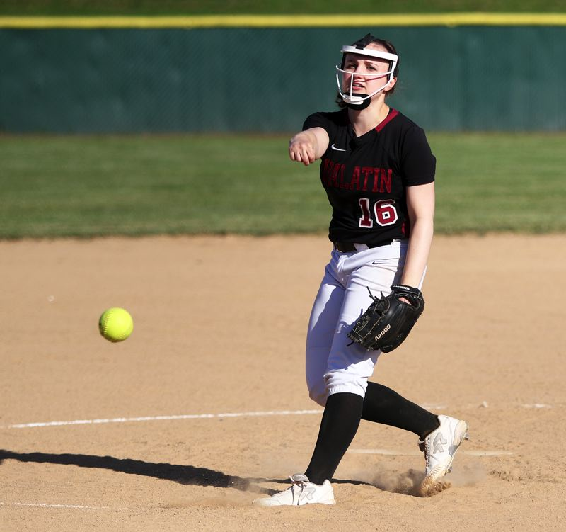 TIMES PHOTO: DAN BROOD - Tualatin senior Megan Woodward fires a pitch to the plate during the Wolves 10-0 state playoff win over Central Catholic on Monday.