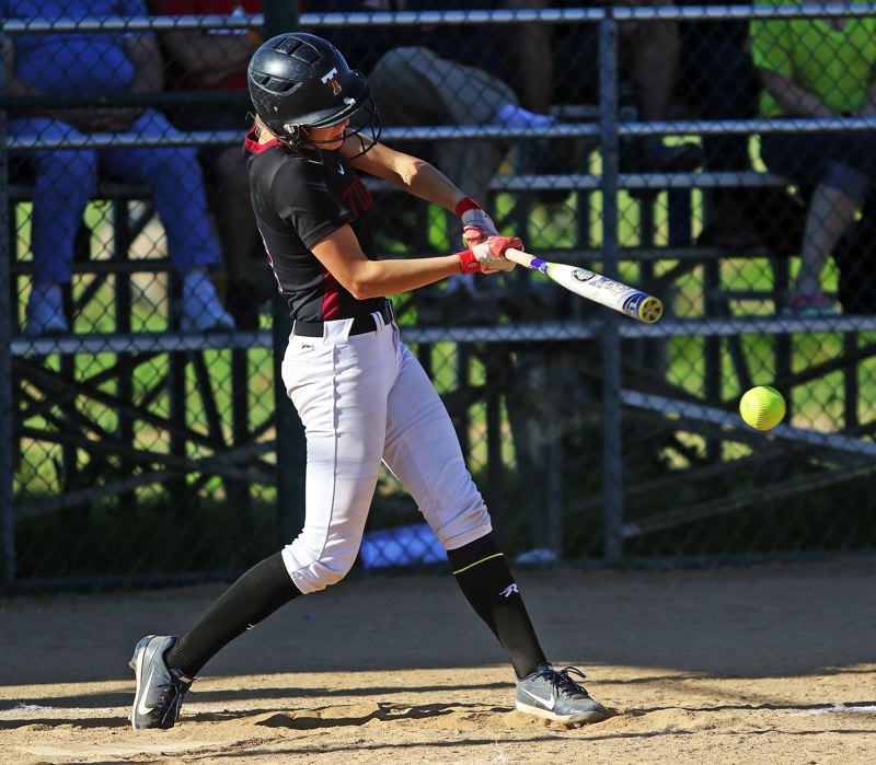 TIMES PHOTO: DAN BROOD - Tualatin senior Ella Hiller smacks a two-run, fourth-inning double during the Wolves 10-0 state playoff win over Central Catholic on Monday.