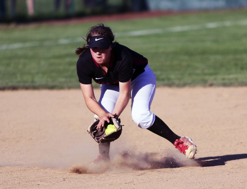 TIMES PHOTO: DAN BROOD - Tualatin sophomore shortstop Bella Valdes fields a grounder during Mondays state playoff game. Valdes hit a grand slam home run in the 10-0 victory.