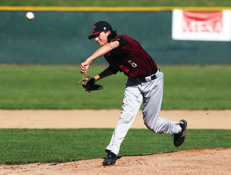 TIMES PHOTO: DAN BROOD - Tualatin senior Danny Shell fires a pitch to the plate during Mondays playoff game with Barlow. Shell threw a complete game in the 4-1 victory.