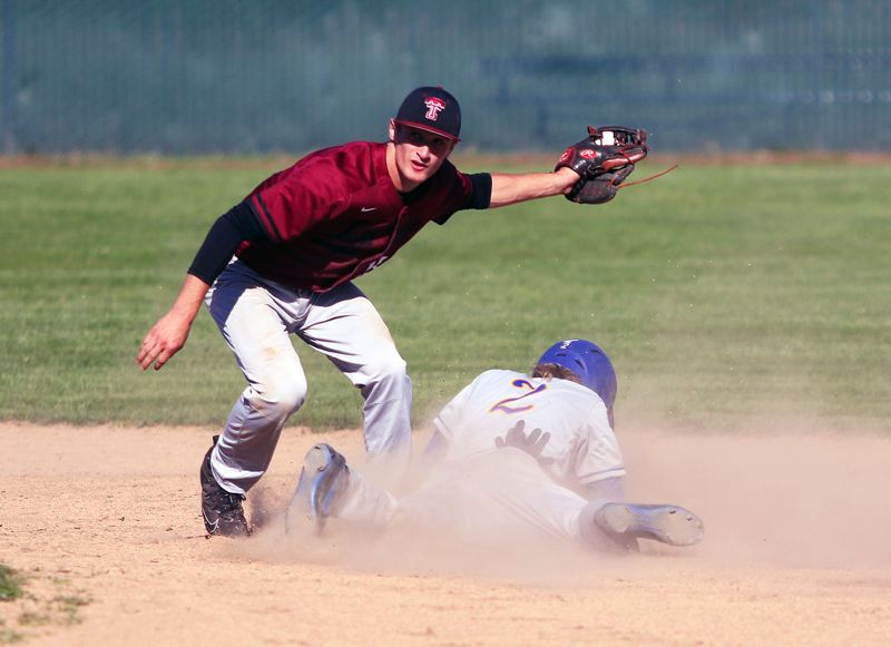 TIMES PHOTO: DAN BROOD - Tualatin senior second baseman Colby Jackson tags out Barlows Tyler Loeb on a stolen base attempt during Mondays state playoff game.