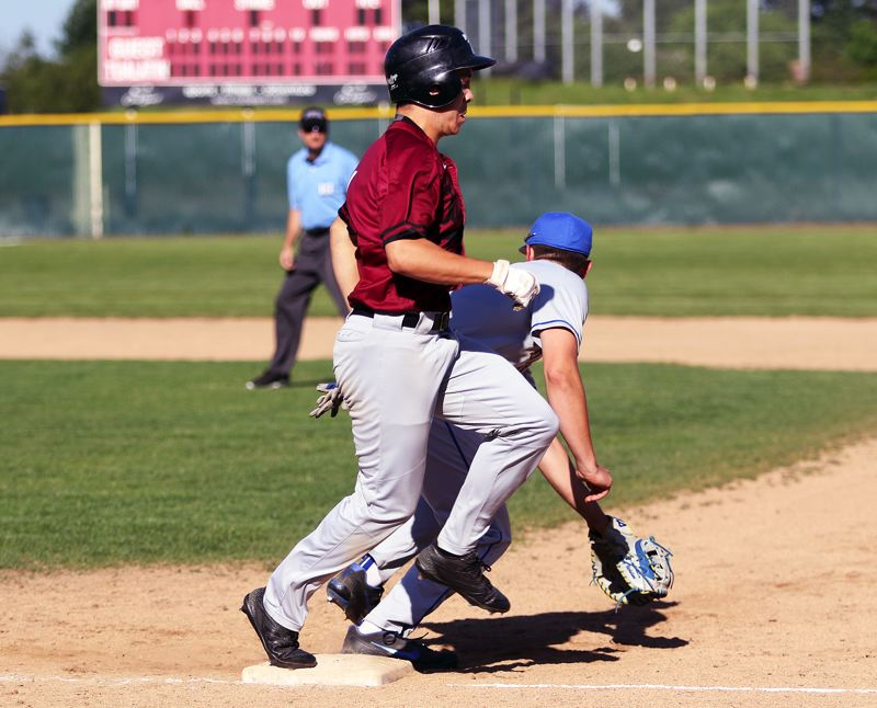 TIMES PHOTO: DAN BROOD - Tualatin High School senior Sean Chamberlin is safe on an infield single in the second inning of Mondays state playoff win over Barlow.