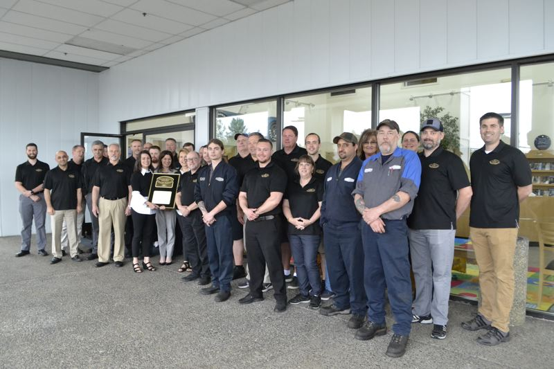 POST PHOTO: BRITTANY ALLEN - Out of the 120 dealerships in the region, only nine received a President's Award this time around, including Sandy Suburban Ford.