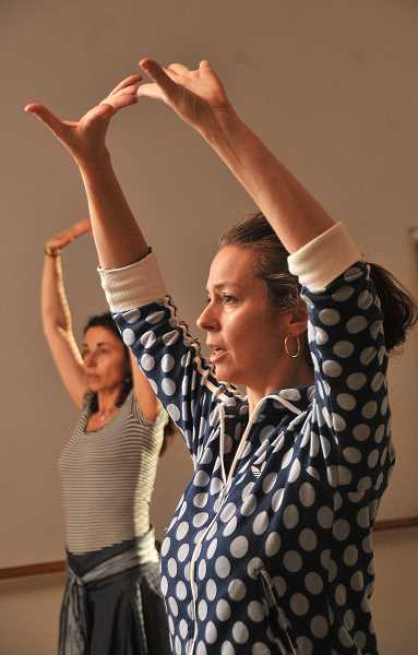 REVIEW PHOTOS: VERN UYETAKE - Laura Onizuka (right) leads her class in traditional flamenco exercises incorporating elegant hand movements that mimic the rhythm of the music.