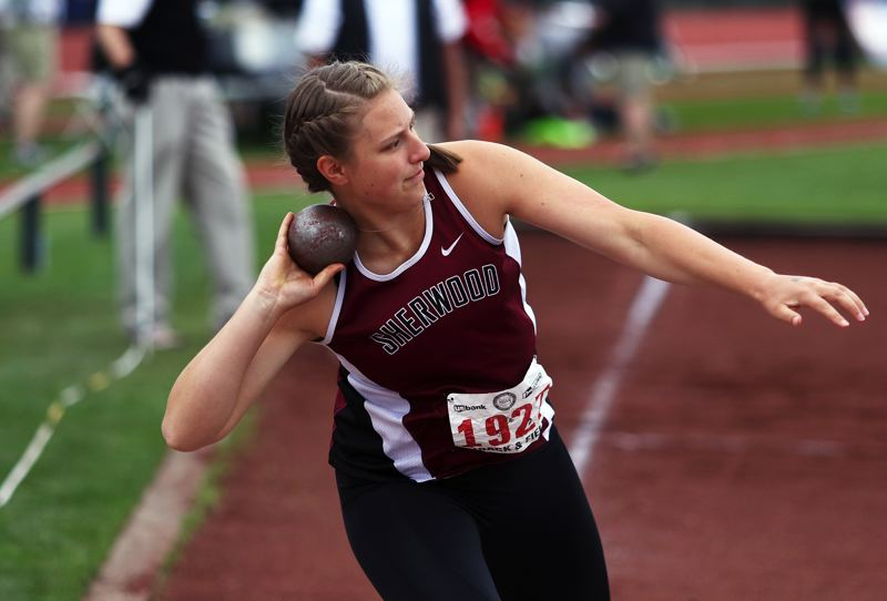 TIMES PHOTO: DAN BROOD - Sherwood High School senior Shelby Moran took first place in the Shot put event at the Class 6A state track and field championships.