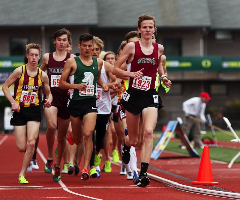 TIMES PHOTO: DAN BROOD - Sherwood High School junior Henry Giles (right) ran to seventh place in the 3,000-meter run at the Class 6A state track and field meet.