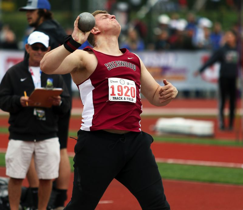 TIMES PHOTO: DAN BROOD - Sherwood High School senior Carsen Christensen took fourth place in the discus event at the Class 6A state track and field championships.