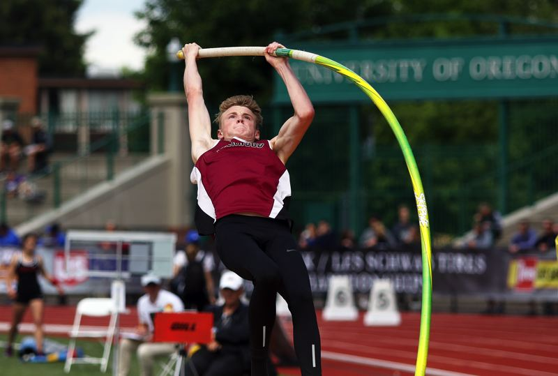 TIMES PHOTO: DAN BROOD - Sherwood High School senior Payton Churilla cleared 13-0 to tie for third place in the pole vault event at the Class 6A state meet.