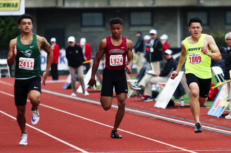 TIMES PHOTO: DAN BROOD - Sherwood sophomore Caleb Hagan (center) reached the finals in both the 100 and 200-meter dashes.