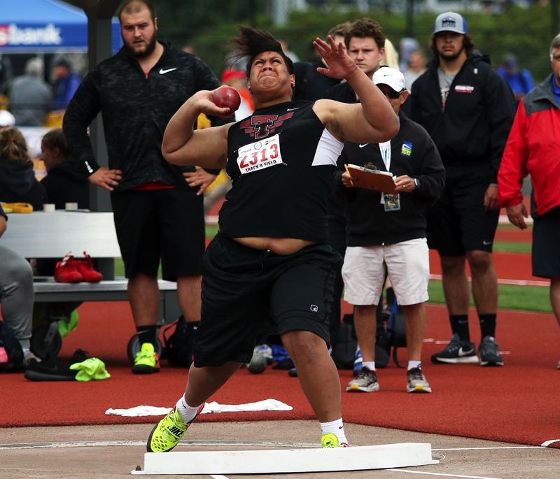 TIMES PHOTO: DAN BROOD - Tualatin senior Gerald Saina is about to let the shot put fly during the Class 6A state track and field championships on Friday.