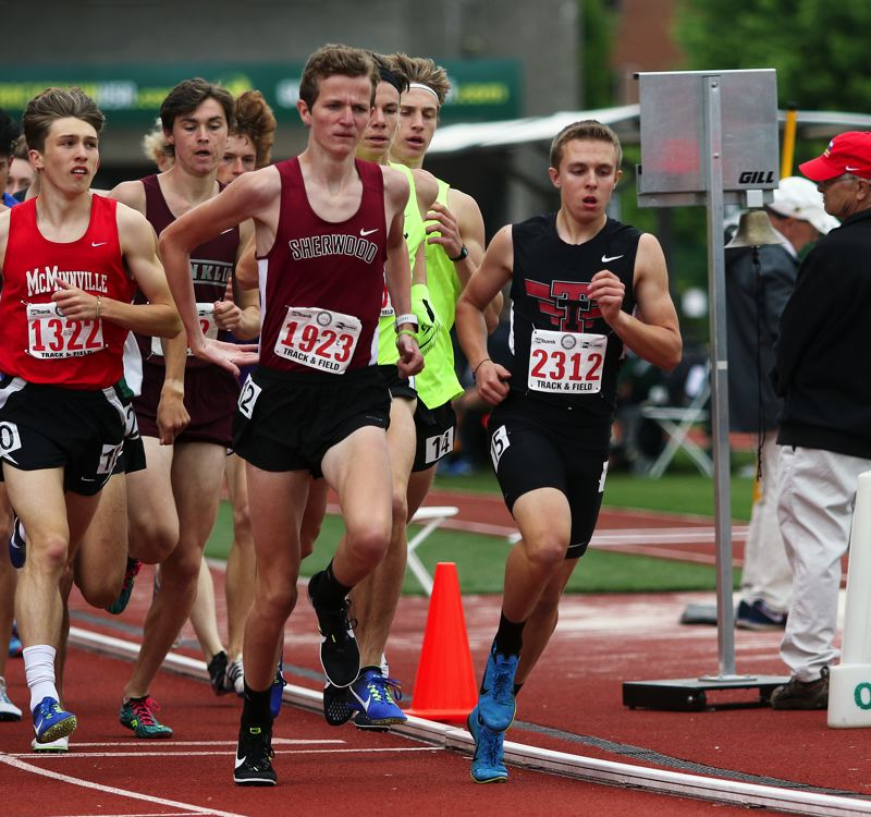 TIMES PHOTO: DAN BROOD - Tualatin sophomore Andrew Payton (right) runs in front of the pack in the 1,500-meter run at the Class 6A state track and field championships.