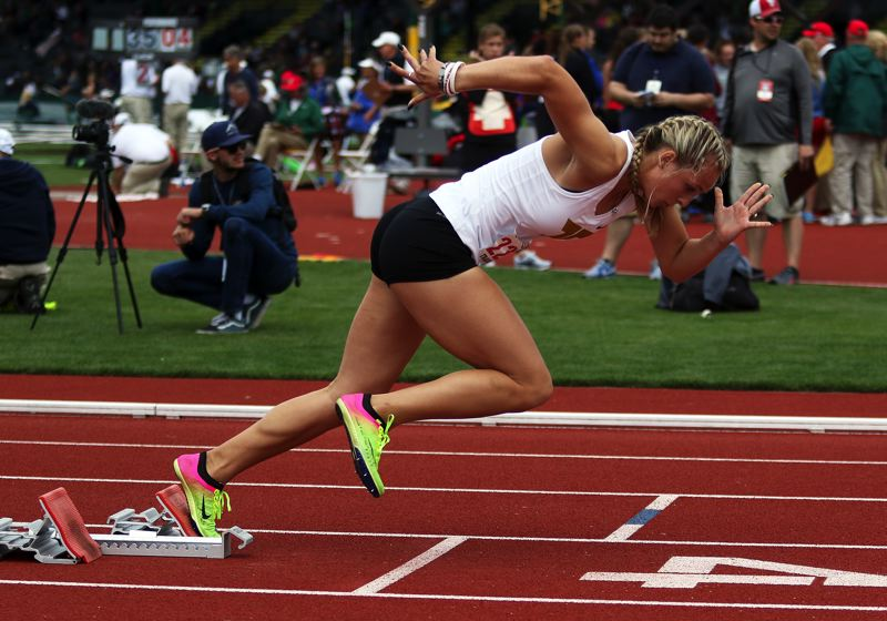 TIMES PHOTO: DAN BROOD - Tigard High School senior Lauren Paven is looking to get off to a fast start in the 400-meter finals at the state meet. She finished in second place.