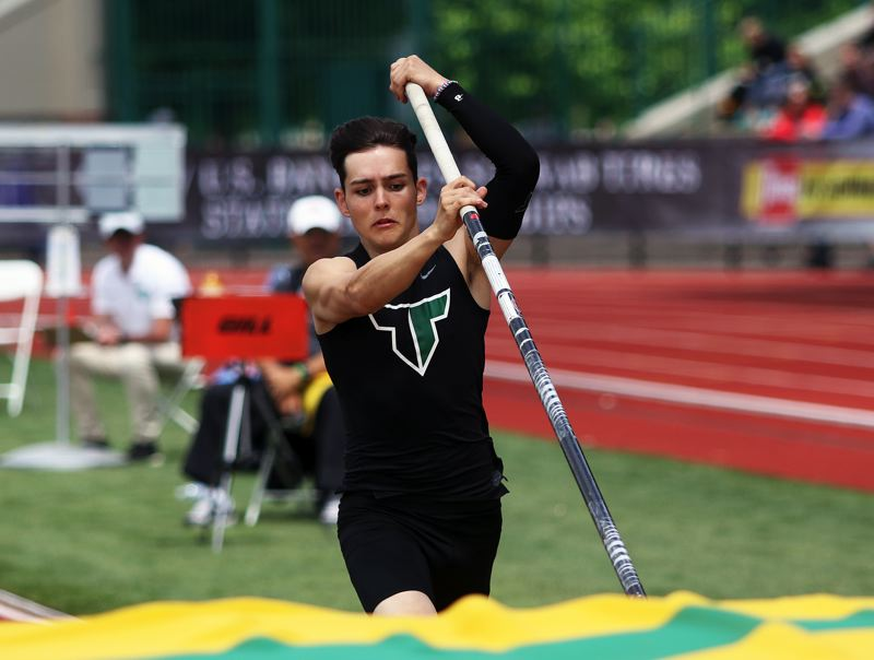 TIMES PHOTO: DAN BROOD - Tigard's Alex Silver is ready to take off in the pole vault competition at the Class 6A state track and field championships.