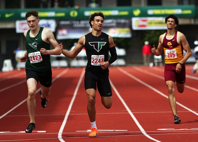 TIMES PHOTO: DAN BROOD - Tigard senior Braden Lenzy (center) ran to second place in the 400-meter dash at the Class 6A state track and field championships.