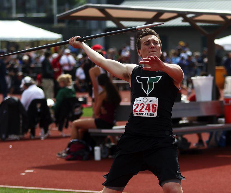 TIMES PHOTO: DAN BROOD - Tigard senior Payton Kueffel is about to let loose with the javelin during competition at the Class 6A state track and field championships.