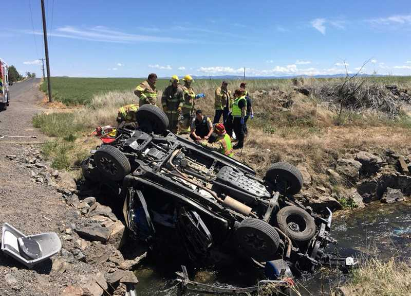 SHERIFF'S OFFICE PHOTO - A Toyota Tacoma being shuttled between boat launchings crashed into an irrigation ditch.
