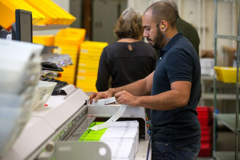 JONATHAN HOUSE/PAMPLIN FILE PHOTO - Multnomah County elections worker Tony Canales sorts through incoming ballots for the November 2016 general election.