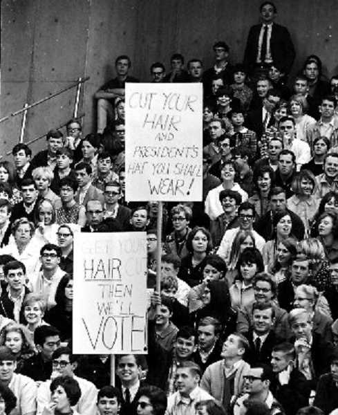 COURTESY TO TOM GEIL - Tom Geil chronicled the crowd's reaction to Robert F. Kennedy's March 1968 speech at PSU including these signs. The top one reads: Cut Your Hair and President's Hat You Shall Wear!