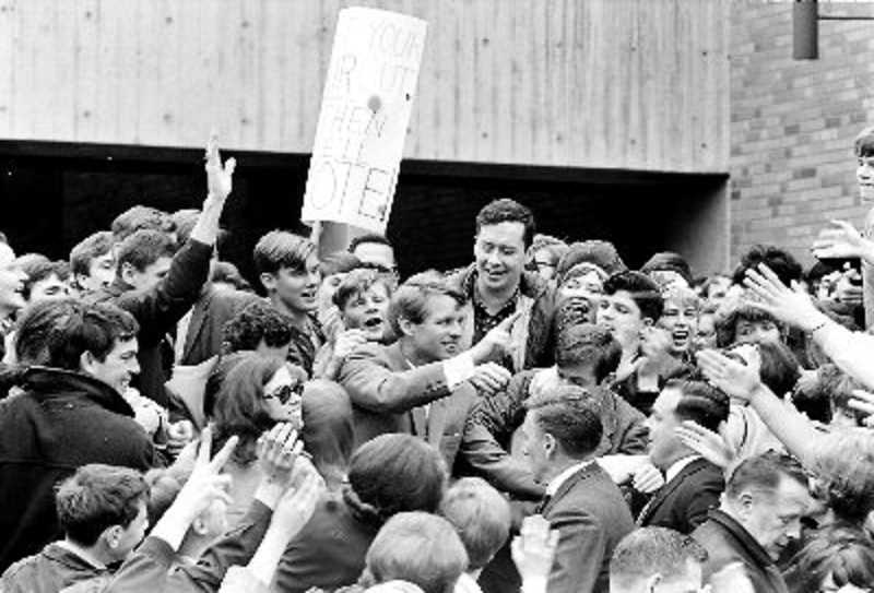 COURTESY OF TOM GEIL - Robert F. Kennedy shook hands with students after a speech at Portland State University in 1968. He recalls that students got close enough to toustle his hair and steal at least one set of cufflinks.