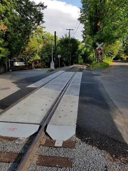 REVIEW PHOTO: ANTHONY MACUK - The railroad crossing at Riverwood Road has been rebuilt to create a smoother ride for both trolleys and cars.