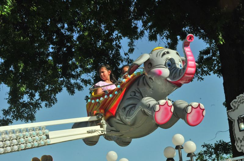 COURTESY: VERN UYETAKE/ROSE FESTIVAL - The carnival rides of Funtastic Traveling Shows get cranked up at CityFair as the Rose Festival opens at Waterfront Park, Friday, May 25. There'll be fireworks happening in the sky about 9:50 p.m. Friday.