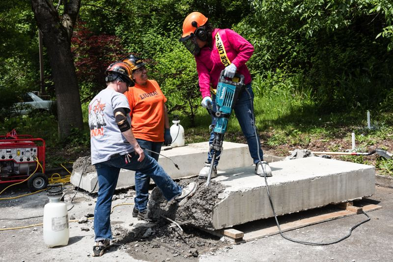 PHOTO: MELISSATOLEDO.COM, COURTESY OREGON TRADESWOMEN - The laborers union provided steel shoe covers for girls who wanted to try out a jack hammer. Agencies such as ODOT and Clackamas County are looking for road crews as transportation packages and the promise of expanded federal infrastructure meet head on with diversity quotas and a retiring Baby Boomer population.