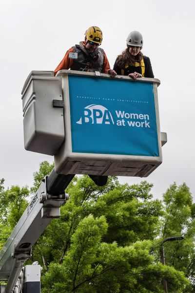PHOTO: MELISSATOLEDO.COM, COURTESY OREGON TRADESWOMEN - A girl tests her comfort with heights in a Genie cherry picker.