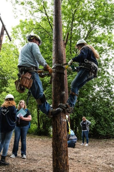 PHOTO: MELISSATOLEDO.COM, COURTESY OREGON TRADESWOMEN - Girls could try out pole climbing on PGE equipment.